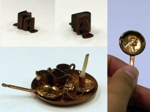 Miniature set of pots and pans made from pennies - University of Iowa Special Collections