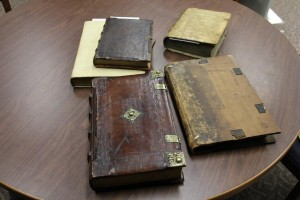 Five 15th century books on a table