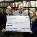 Special Collections staff with an oversized check