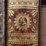 Close of of the gold decoration on the spine of a book