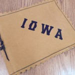 "Image of scrapbook with ""Iowa"" written on the front"