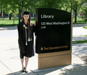 photo of Lindsay Moen standing next to the library