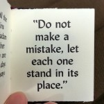 "Page from a book with quote ""Do not make a mistake, let each one stand it its place."""