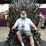 Peter Balestrieri sitting on the Iron Throne at World Con