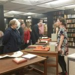 Iowa Bibliophiles browsing new acquisitions