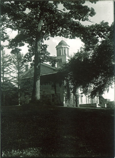 Old Capitol among trees, The University of Iowa (1920s?) | Iowa City Town and Campus Scenes