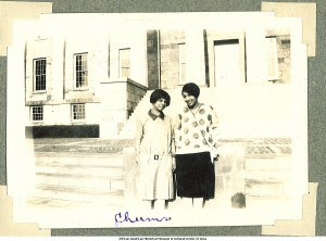 Althea Moore and friend on steps of Old Capitol, Iowa City, Iowa, between 1924 and 1928