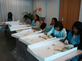 Students dry cleaning books using erasures and other techniques