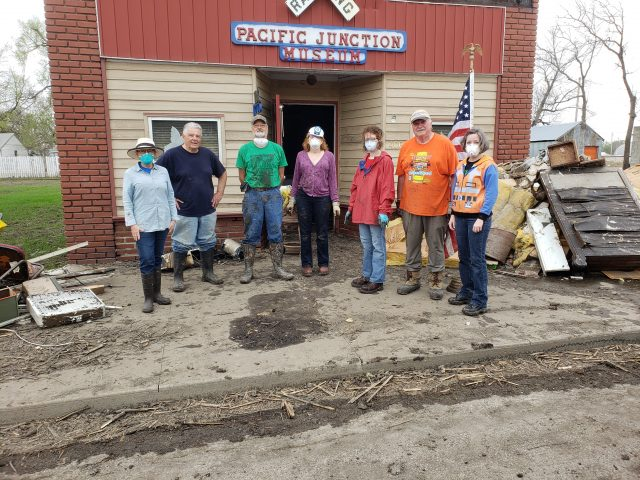 Seven IMALERT members pause for a group photo in front of the Pacific Junction Railroad Museum.