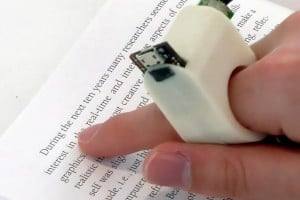 FingerReader, wearable interface for reading on-the-go. MMIT Media Lab.