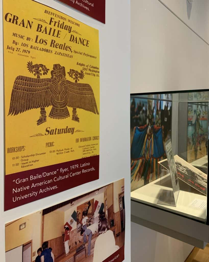 A photo showing a poster and photos on display in the Main Library Gallery.
