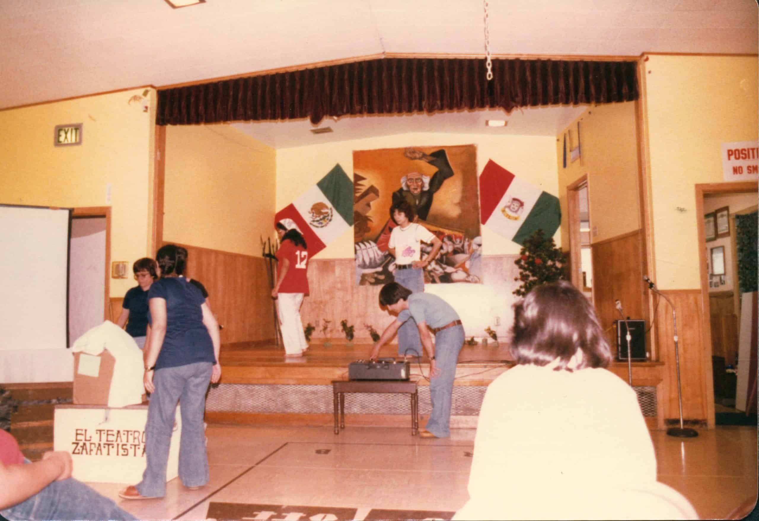 Students setting up on stage in preparation for a performance.