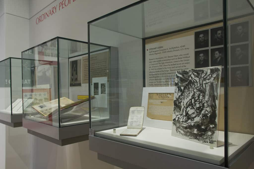 Artifacts in wall cases inside the Main Library Gallery.