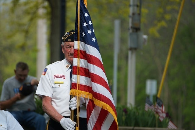 photo of veteran with flag