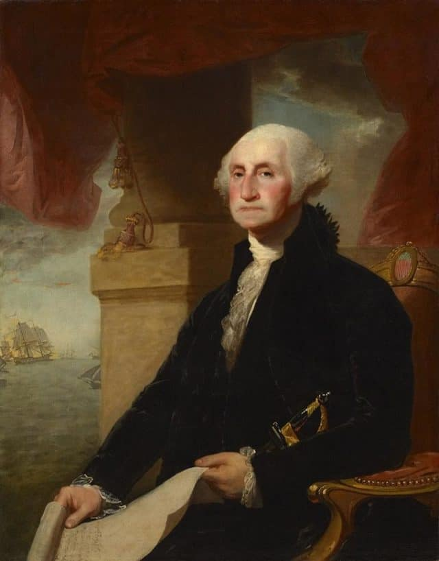 picture of George Washington, seated, with paper in his hand and a ship in the background