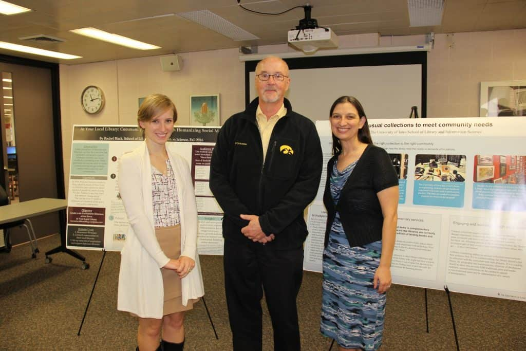 Two SLIS students at their poster sessions