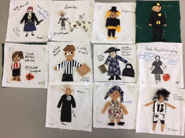 Quilt squares about Iowa women, by Iowa girls.