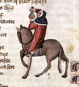 image of hooded man on horse with bottle of potion