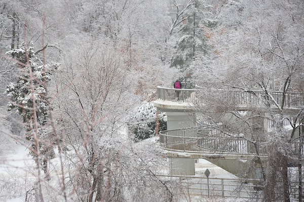 student walking on bridge in winter