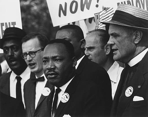 MLK in group at Civil Rights March; black and white photograph