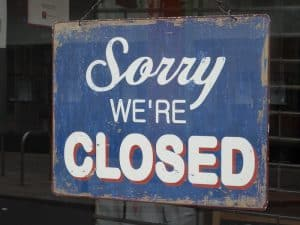 sign saying sorry we're closed/blue and white, distressed