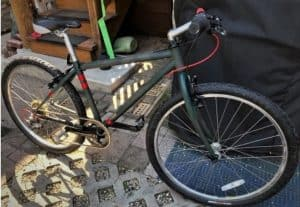 gray specialized 1994 rockhopper womens bike in garage