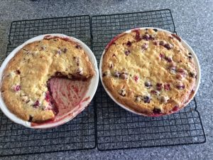 2 cranberries pies on cooling rack with one big piece eaten
