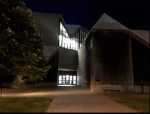 photo of Hardin Library in the dark with lighted door and window