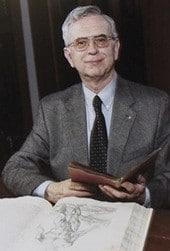 photo of Dick Eimas with 2 rare books