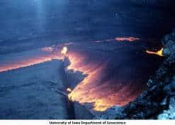 Image of Cool dark lava subducting, exposing red-hot lava