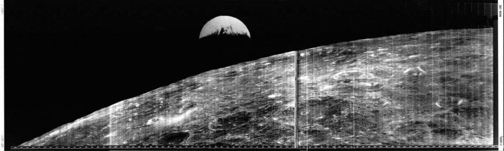 Lunar Orbiter 1 new of the Moon and crescent Earth.