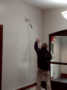 Man painting the Sciences Library