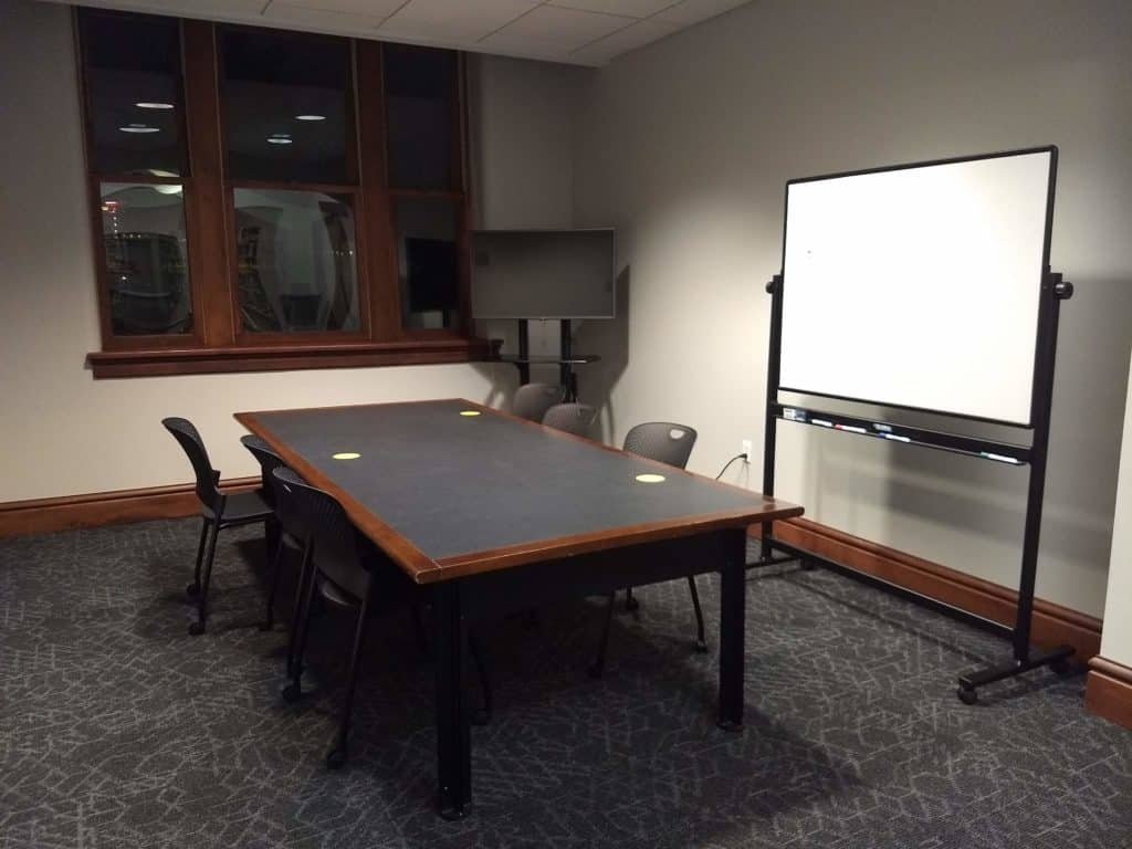 Photo of table and white board