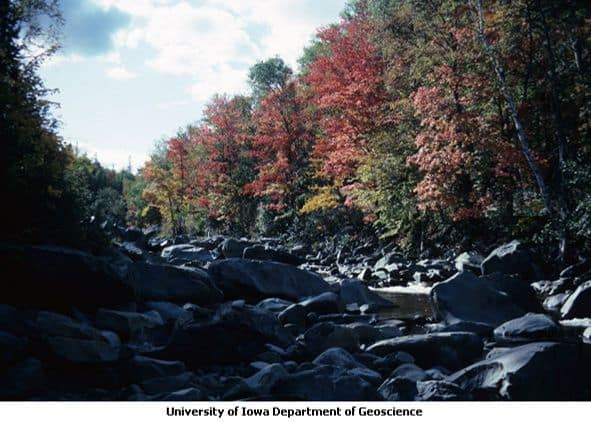 Image of Autumn colors along bouldery stream