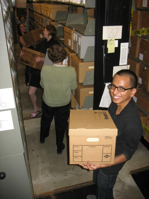 Smiling student holds a box