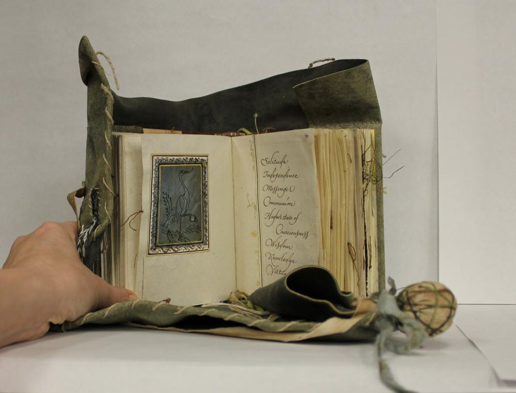 Small parchment book with leater girdle book binding