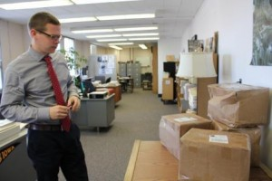 Patrick Olson inspecting packages