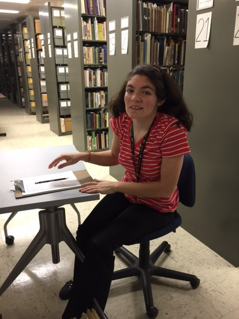 Lucy Hartmann at work in Special Collections.