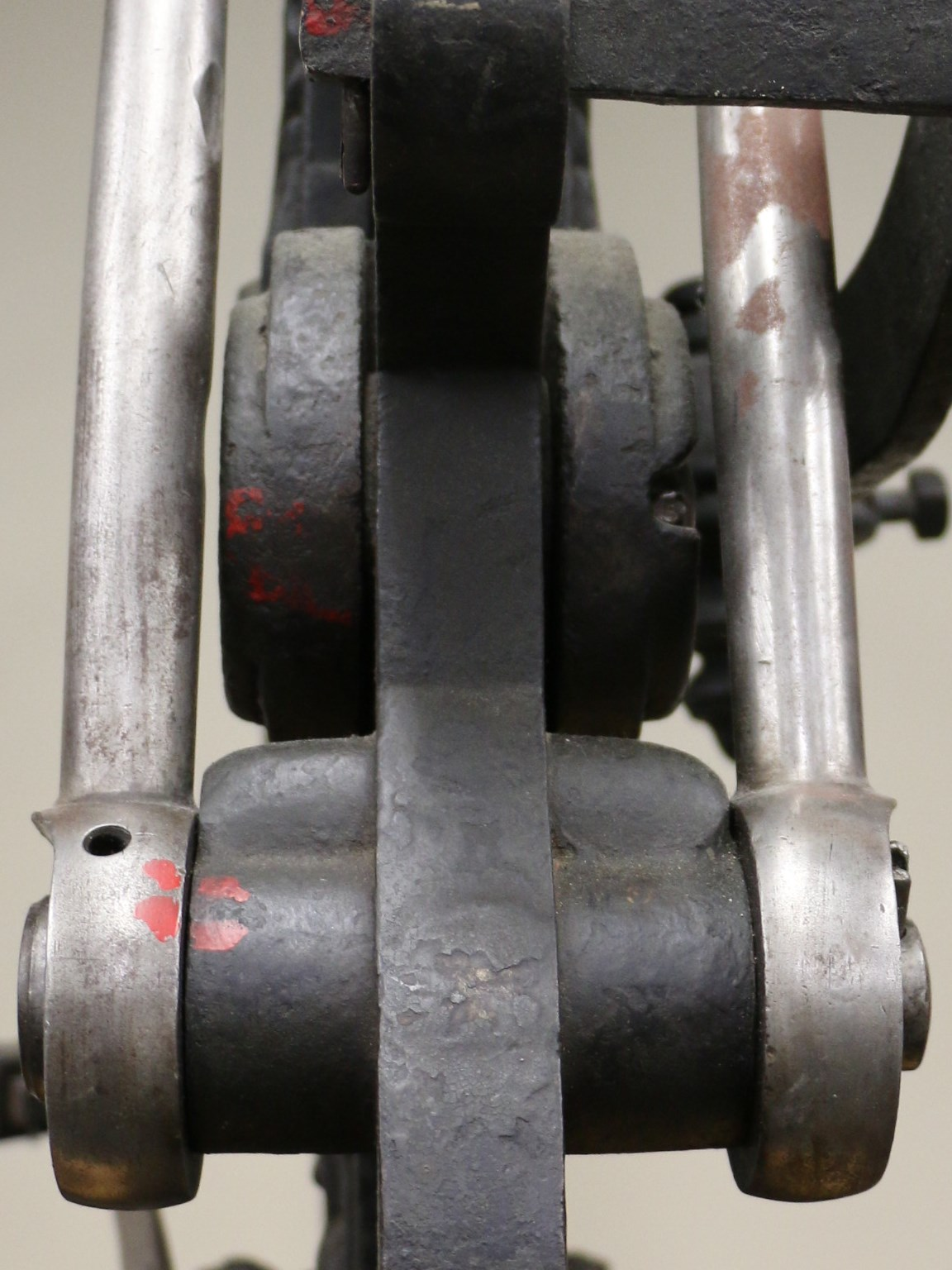 Close up view of the gears of a hand press