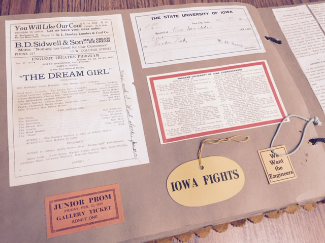 an image of the inside of the scrapbook featuring an Iowa Fights label, and other university promotional material