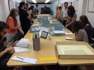 an image of students looking at Fluxus materials in the Special Collections classroom