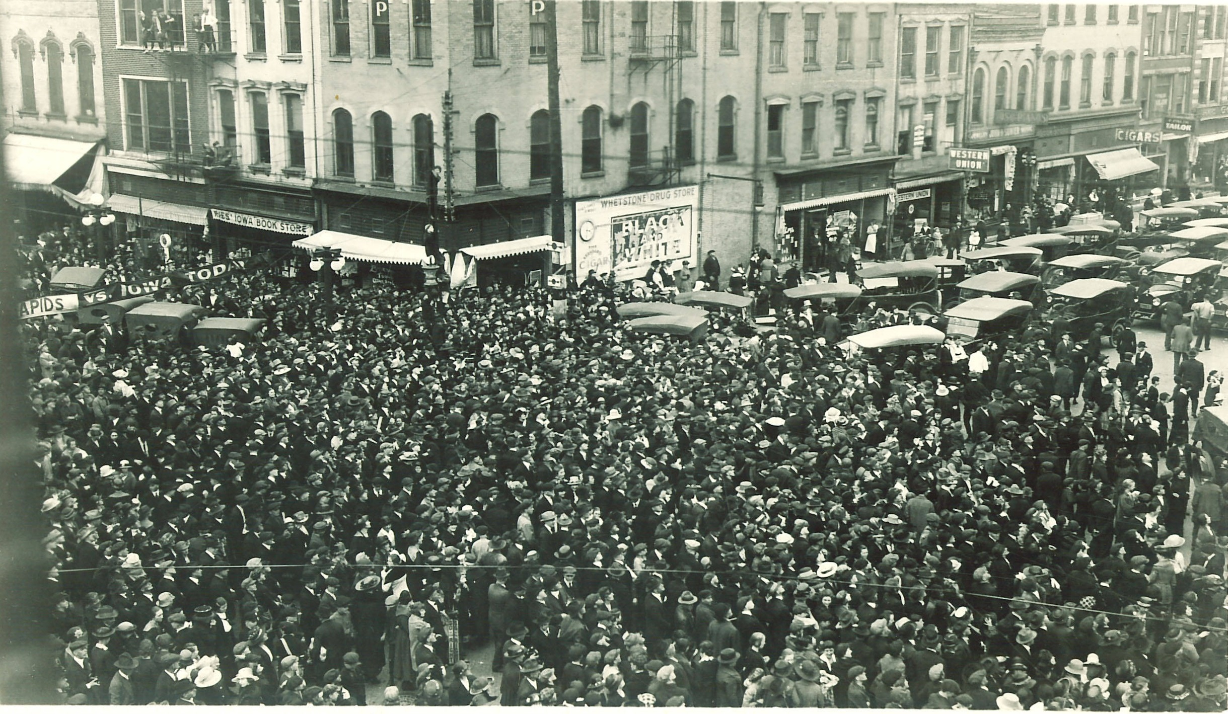 crowd waiting to buy football tickets in 1920