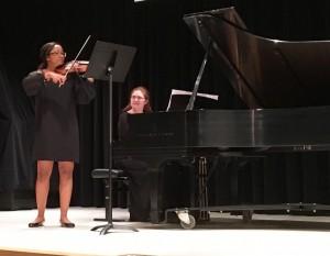 Mallory playing at her Violin recital.