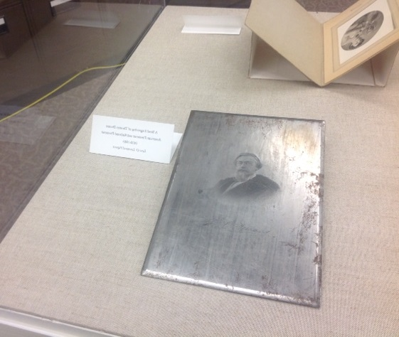 Image of an engraved plate with a portrait on it