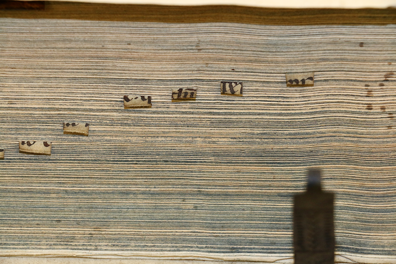 Book tabs made from recycled manuscripts
