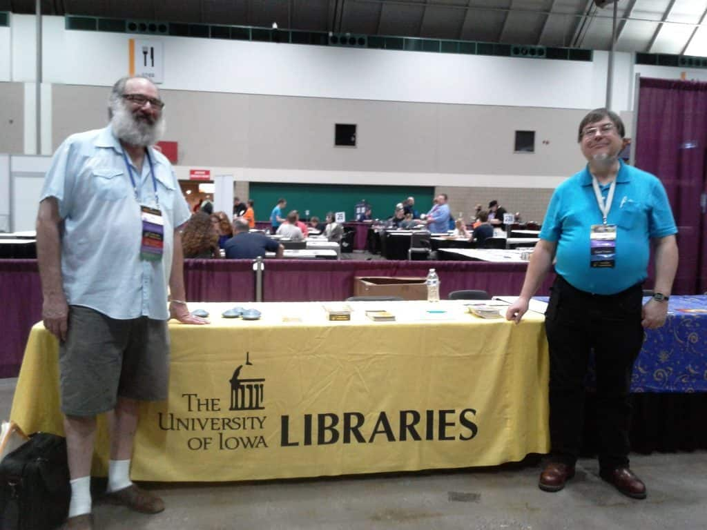 Peter and Higgins at the UI libraries table at World Con