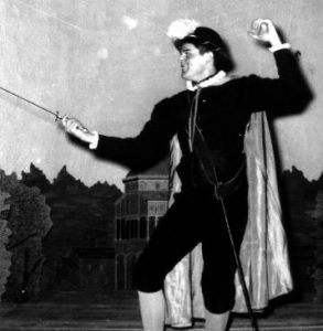 shakespearean actor in fencing stance