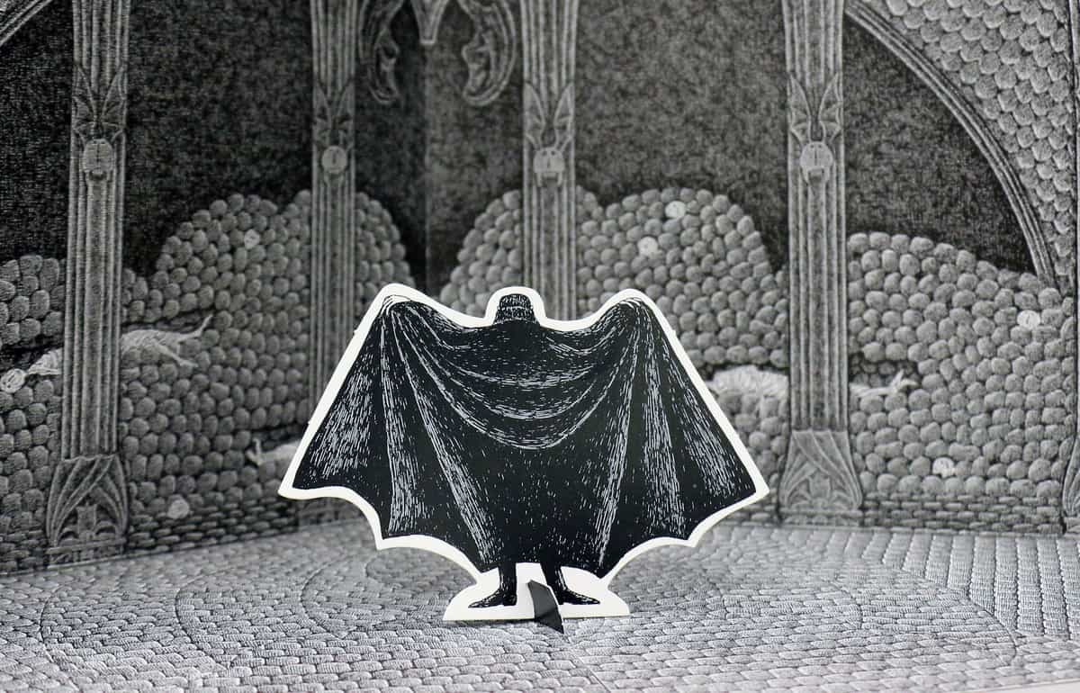 Dracula's bat-like cape taking center stage
