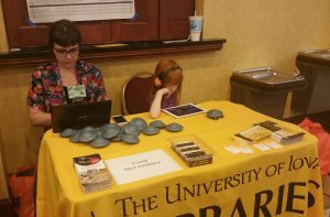 A woman and a girl sitting at a UI Libraries table