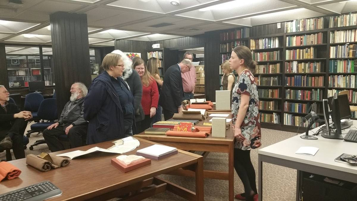 Iowa Bibliophiles browsing new acquisitions